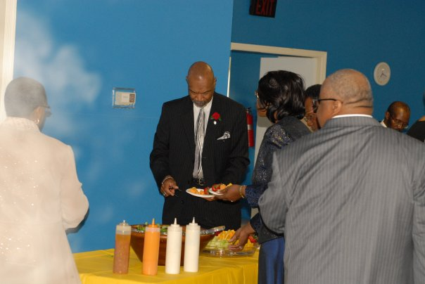 Rev. Parker surrounded by the spirit